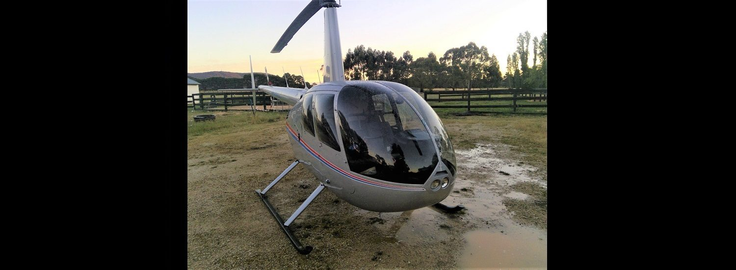 R44 Silver with RB1500 x 550 | Leaders in Helicopter Sales and Service - Heliflite