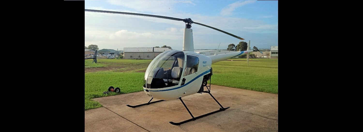 R22 White with Bright Blue 1500 x 550 | Leaders in Helicopter Sales and Service - Heliflite