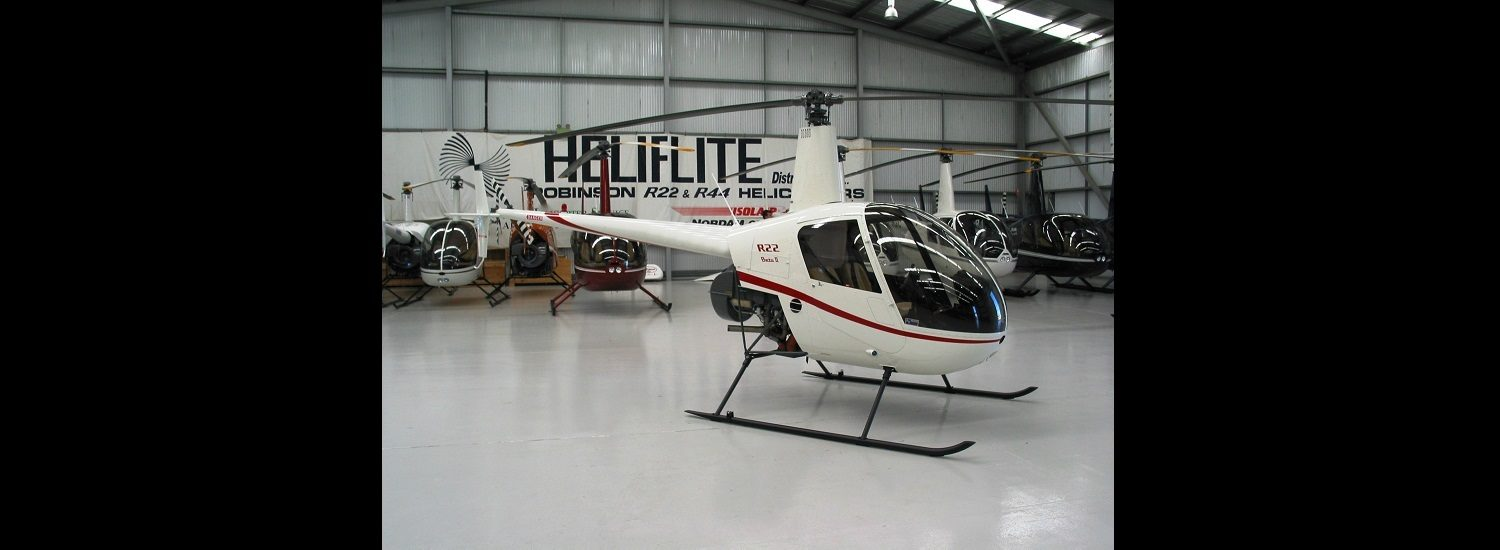 R22 White with Red Trim | Leaders in Helicopter Sales and Service - Heliflite