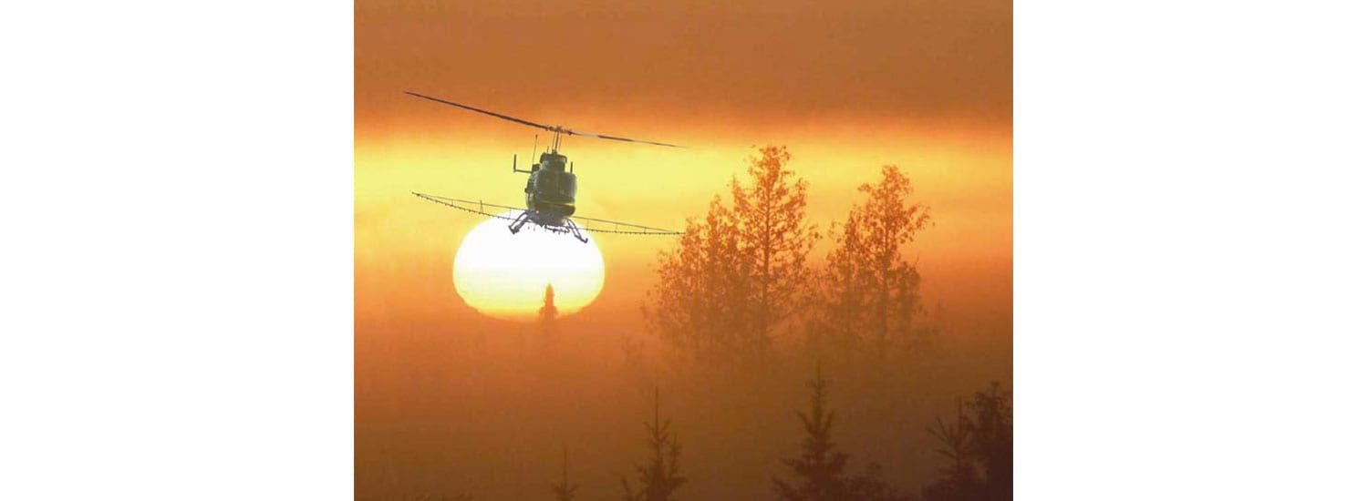 bell-sunset-spray | Leaders in Helicopter Sales and Service - Heliflite