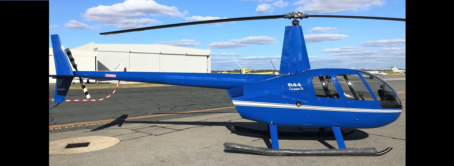 R44 Clipper II Blue with White Trim 1500 x 550 | Leaders in Helicopter Sales and Service - Heliflite