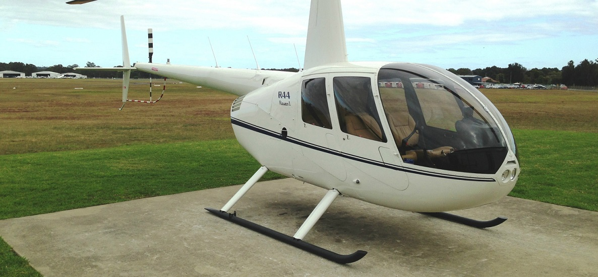 R44 White with Dark Blue Trim 1186 x 550 | Leaders in Helicopter Sales and Service - Heliflite