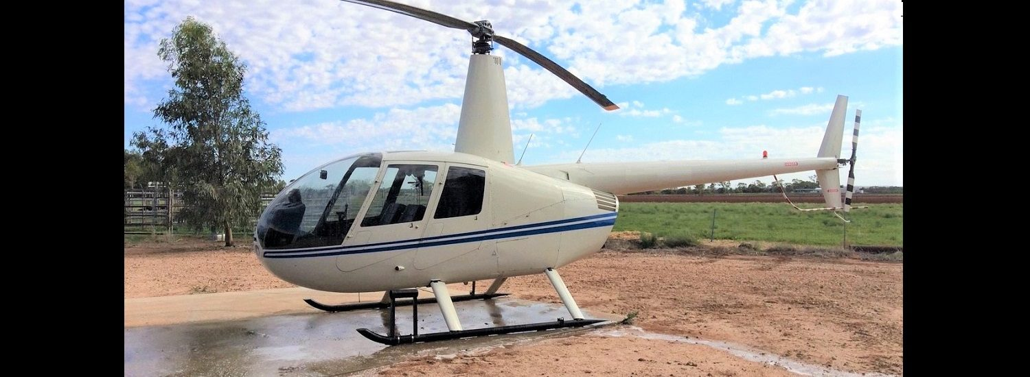 R44 White with Bright Blue Trim 1500 x 550 | Leaders in Helicopter Sales and Service - Heliflite
