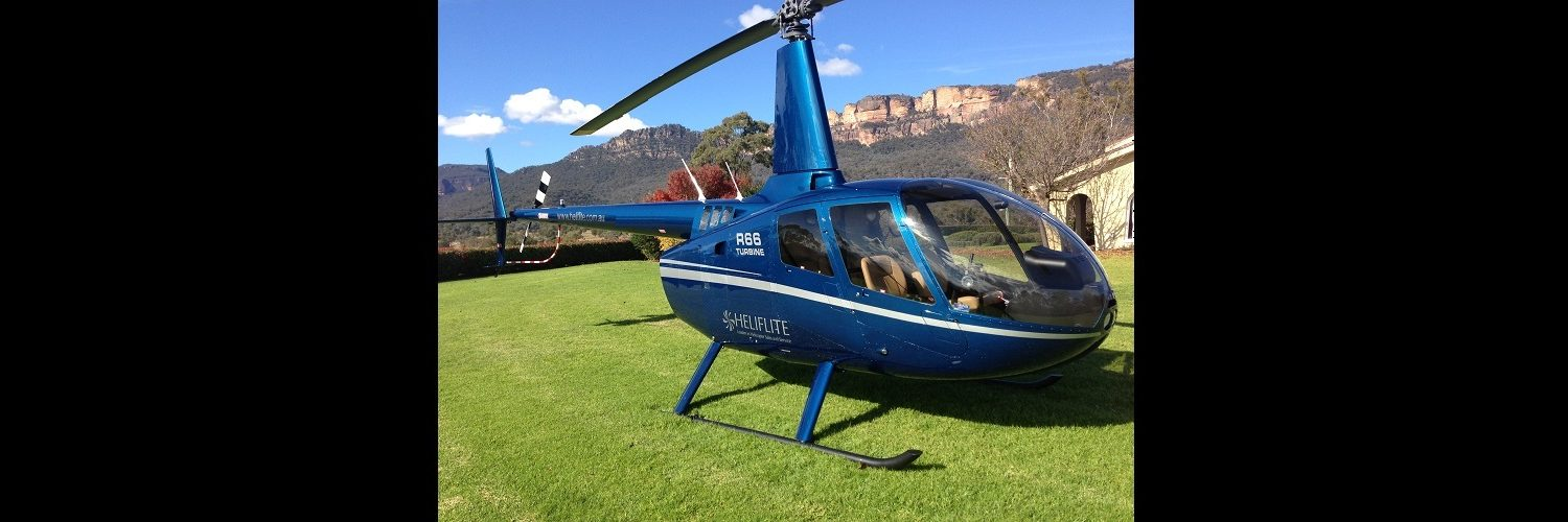 R66 Dark Blue with Grey Trim (1)   Leaders in Helicopter Sales and Service - Heliflite